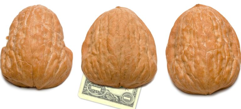 Walnut Shells hiding a dollar the tax game. tired of playing it yet? The Tax Game. Tired of Playing it yet? shell game